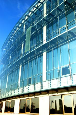 Office building is constructed of glass and concrete  photo