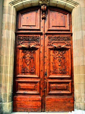 Old wooden door decorated with carvings