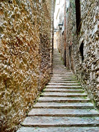 Old stone staircase receding into the past Stock Photo