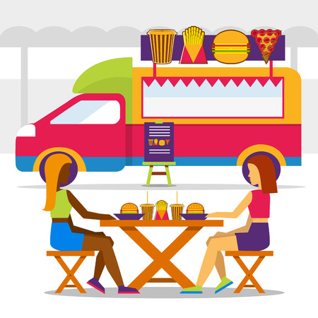seating area: Food truck festival. Food truck with girls in seating area and eating jungle food.