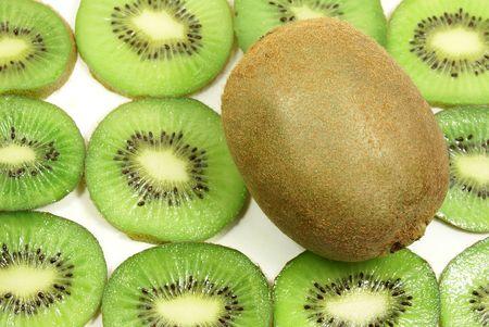 fresh kiwi fruit against kiwi slices photo