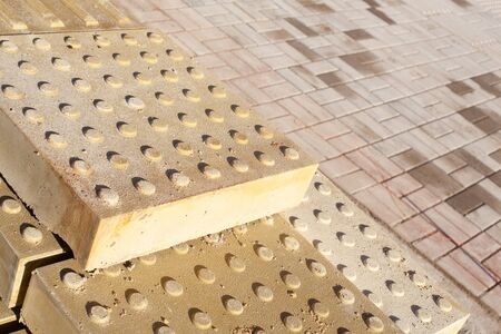 new Yellow Tactile Paving or Detectible Warning Pavers tile blocks for Disabled and curb Standard-Bild