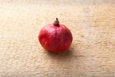 Ripe pomegranate fruit on a wood background