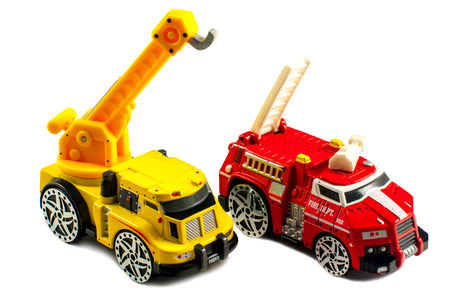 antique fire truck: Small toy fire engine and a crane isolated on a white background
