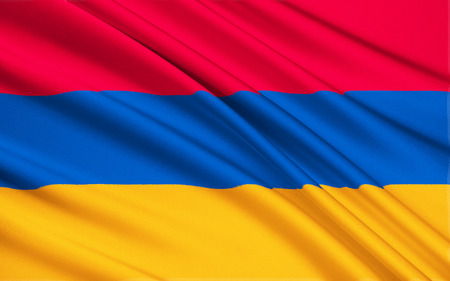 soviet flag: The national flag of Armenia, the Armenian Tricolor or Yeraguyn. The Armenian Supreme Soviet adopted the current flag on 24th August 1990. Stock Photo