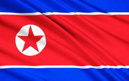 ensign: The flag of North Korea was adopted on 8 September 1948, as the national flag and ensign of this isolationist Stalinist state. Stock Photo