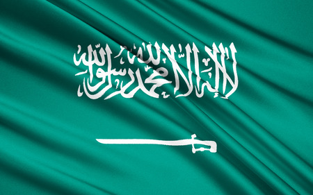 green been: The flag of Saudi Arabia has been used by the government of Saudi Arabia since March 1973. It is a green flag featuring in white an Arabic inscription and a sword. The inscription is the Islamic creed, or shahada. Stock Photo