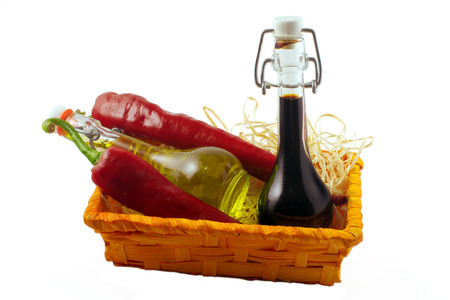 chilly: Two bottles of wine vinegar, olive oiland two red hot chilly pepper isolated on white background Stock Photo