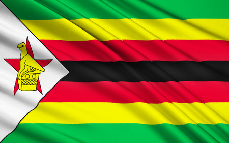 soapstone: Flag of Zimbabwe - adopted on 18th April 1980, when Zimbabwe was granted independence by the United Kingdom. The soapstone bird featured on the flag represents a statuette of a bird found at the ruins of Great Zimbabwe. Stock Photo
