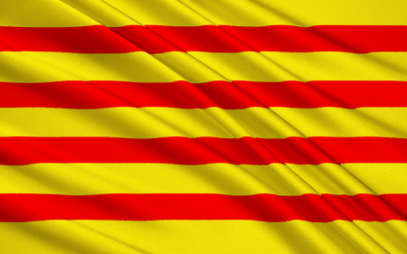 The Senyera is a vexillological symbol based on the coat of arms of the Crown of Aragon, which consists of four red stripes on a golden background Stock Photo