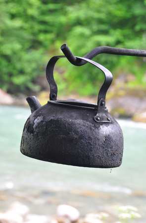 amp: ?amp tea kettle on a background of mountains and rivers Stock Photo