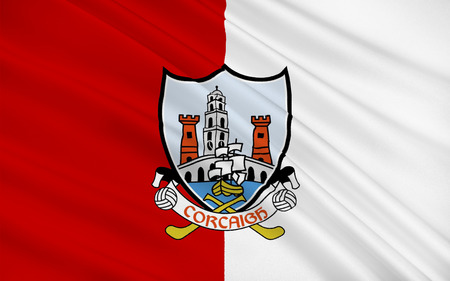 contae: Flag of County Cork is the largest and southernmost county in Ireland. Located in the province of Munster, it is named after the city of Cork. Cork County Council is the local authority for the county. Its largest towns are Cork City, Carrigaline, Midleto