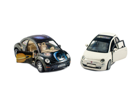 dinky: Two little toys cars isolated on white background