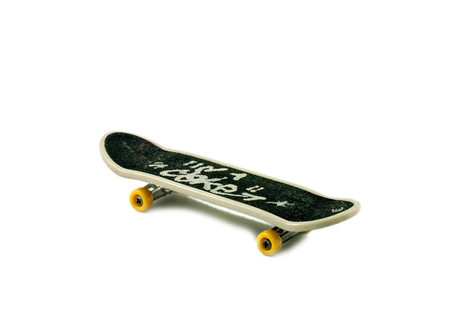 fingerboard: Fingerboard (small copy of skateboard) on white background with shadow. Stock Photo