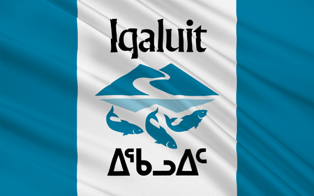 territorial: Flag of Iqaluit is the largest city and territorial capital of the Canadian territory of Nunavut Stock Photo