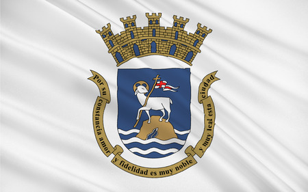 populous: Flag of San Juan is the capital and most populous municipality in the Commonwealth of Puerto Rico, an unincorporated territory of the United States Stock Photo
