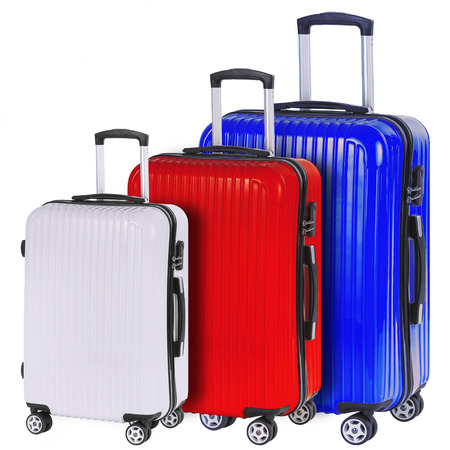 portmanteau: Three suitcases red, white and blue isolated on white background