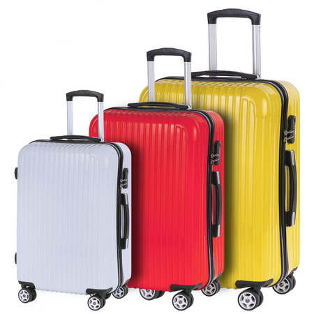 portmanteau: Three suitcases red, white and yellow isolated on white background Stock Photo