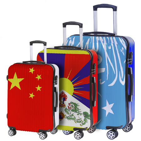 portmanteau: Three suitcases with the image of the flags China, Tibet and Xinjiang