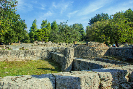 excursion: Tourists on excursion in ruins of ancient Olympia in Greece Stock Photo