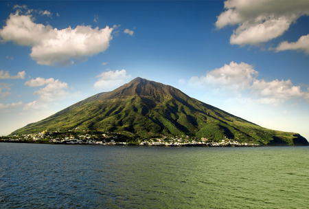 Stromboli volcanic island in Lipari, viewed from the ocean, Sicily, Italy.