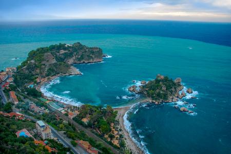 bella: Aerial view of Isola Bella beach coast in Taormina, Sicily, Italy