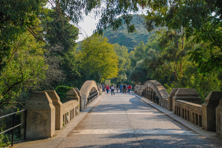 Peloponnesus, Mycenae, Greece - October 01, 2009: Tourists on a trip to the stone bridge that leads to the Ancient Olympia