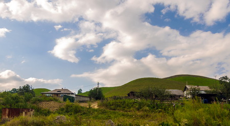 Village in the background of the green hills in the Karachaevo-Cherkess Republic, Russia