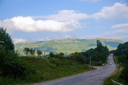 The mountain road, landscape and the blue sky