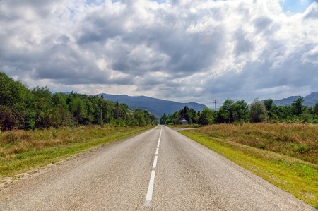 The road has no end, the landscape and the blue sky Stock Photo - 86267994