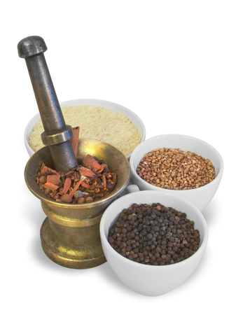 to ponder: Brass ponder and white cups with rice, buckwheat, pepper and spices Stock Photo