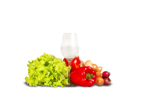 greenery: Group of various vegetables and greenery with water glass