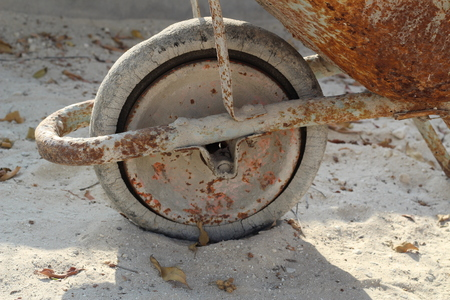 aluminum wheels: Old, rust tire on wheel barrow.