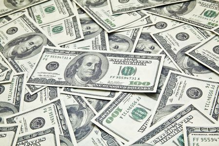 Scattered 100 USD Bills Stock Photo