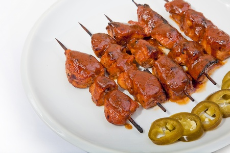 Shish Taouk dish with jalapeno pickles
