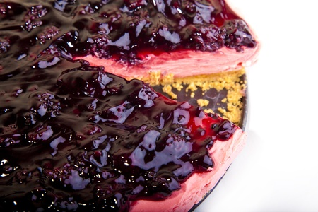 strawberry flavored cheese cake with blackberry topping Stock Photo