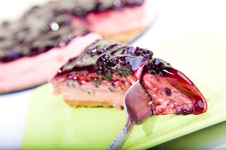 Strawberry flavored Cheese cake slice with blackberry topping Stock Photo