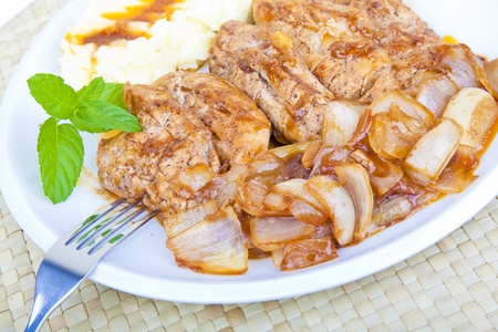 Grilled chicken steak with onions and mashed potatoes Stock Photo