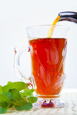 close-up on Pouring hot tea with fresh mint Stock Photo