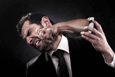 angry businessman: Man gets punched through a smart phone on the face by an angry caller