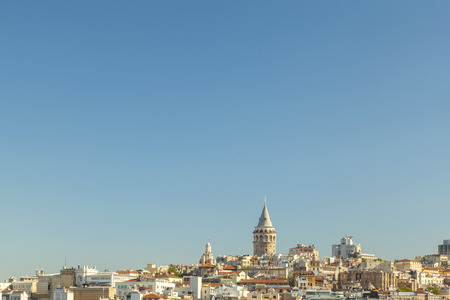 Wide view of Galata tower, partially obscured by old buildings with plenty copy space  Istanbul, Turkey
