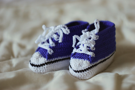 Knitted gumshoes for a little boy photo