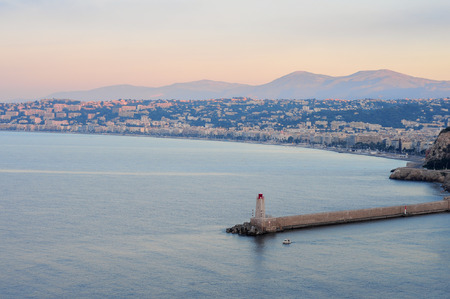 cote d'azure: Early morning, view of Nice, sea and lighthouse at sunrise