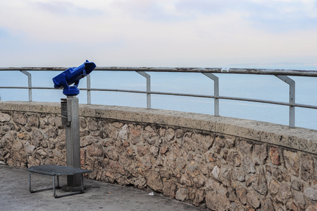 cote d'azure: Binoculars in point of view in Nice at sunrise Stock Photo