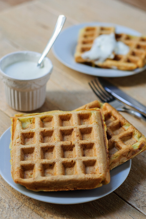 sour cream: Zuccini homemade hash brown waffles with sour cream