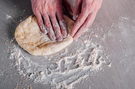 margherita: Man chef making dough for pizza Margherita