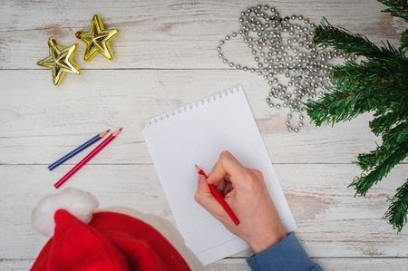miracle tree: Man writing letter to Santa in Christmas atmosphere