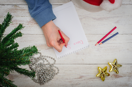 christmas atmosphere: Man writing letter to Santa in Christmas atmosphere