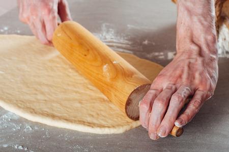 yeast: Man hands making yeast dough for estonian pastry kringel