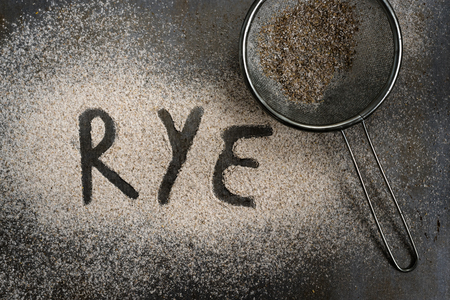 sifter: Sifted rye flour on oven tray with word on it